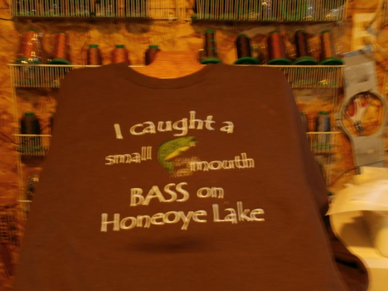I caught a small mouth bass in Honeoye lake fishing ice fishing custom apparel